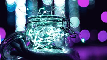 A glass jar illuminated at night
