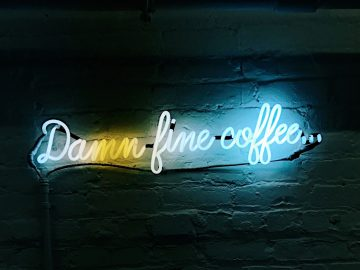 "Neon sign: ""Damn fine coffee..."""